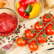 Ingredients for making tomato sauce with slices of bell pepper - Stock Photo