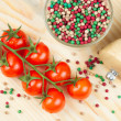 Cherry tomatoes with pepper on chopping board — Stock Photo