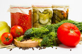 Jars of pickled vegetables. Marinated cucumber, tomato, zucchini — Stock Photo