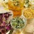 Healing herbs and healthy tea on wooden table, herbal medicine — Stock Photo #10720124
