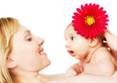 Beautiful loving mother and baby girl — Stock Photo