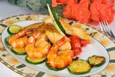 Dish: fried fish fillets, shrimp, zucchini — Stock Photo