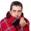 Man wrapped in a warm blanket shivering from the cold — Stock Photo