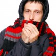 Royalty-Free Stock Photo: Man in winter clothes shivering from the cold