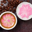 Two cups of beautiful coffee art cappuccino — Stock Photo
