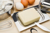 Baking ingredients on wooden board — Stock Photo