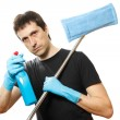 Handsome young man with cleaning supplies — Stock Photo