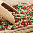 Colorful peppercorns mix, wooden scoop — Stock Photo