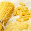 Different types of raw pasta, noodle, spaghetti, tortiglioni on — Stock Photo