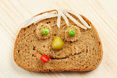 Bread slice as smiling face — Stock Photo