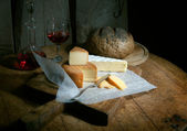 Rustic still life with cheese — Stock Photo