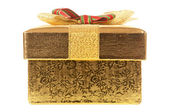 Closed gold gift box — Stock Photo