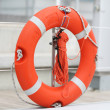 Stock Photo: Lifebuoy with rope hung