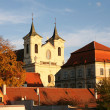 Stock Photo: Buildings with Church, enlightened sunset