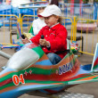 Driving on an attraction in park — Stok fotoğraf