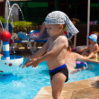 The little boy at children pool - Stock Photo