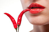 Young woman with chili pepper isolated on white — Stock Photo