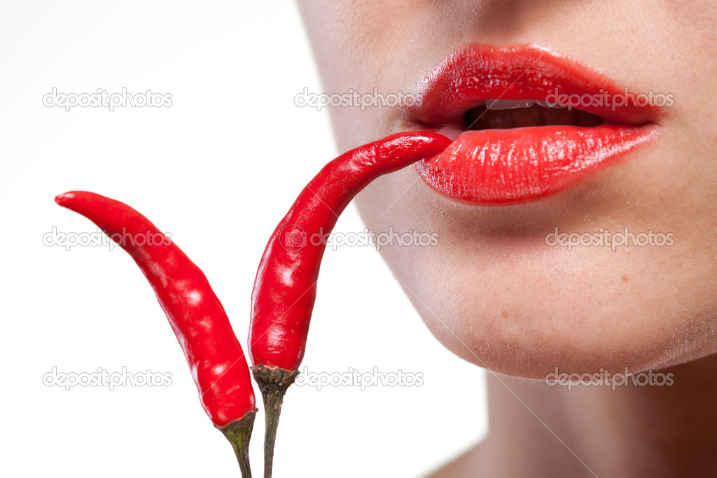 Young woman with chili pepper isolated on white  Stock Photo #8483079