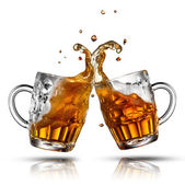 Beer splash in glass isolated on white — Stok fotoğraf