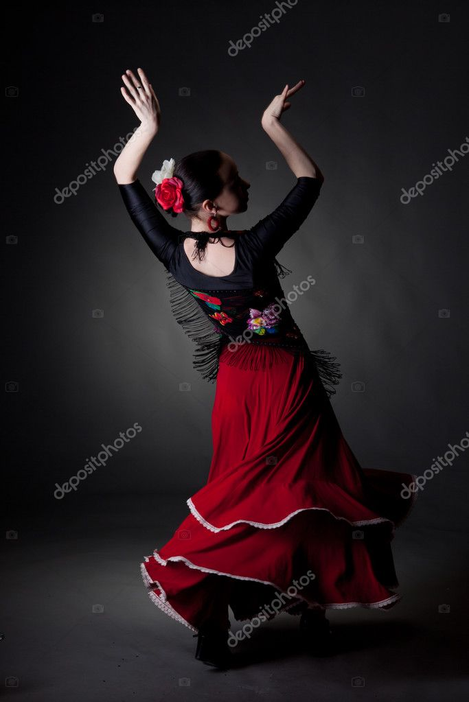 Young woman dancing flamenco on black — Stock Photo #8867440