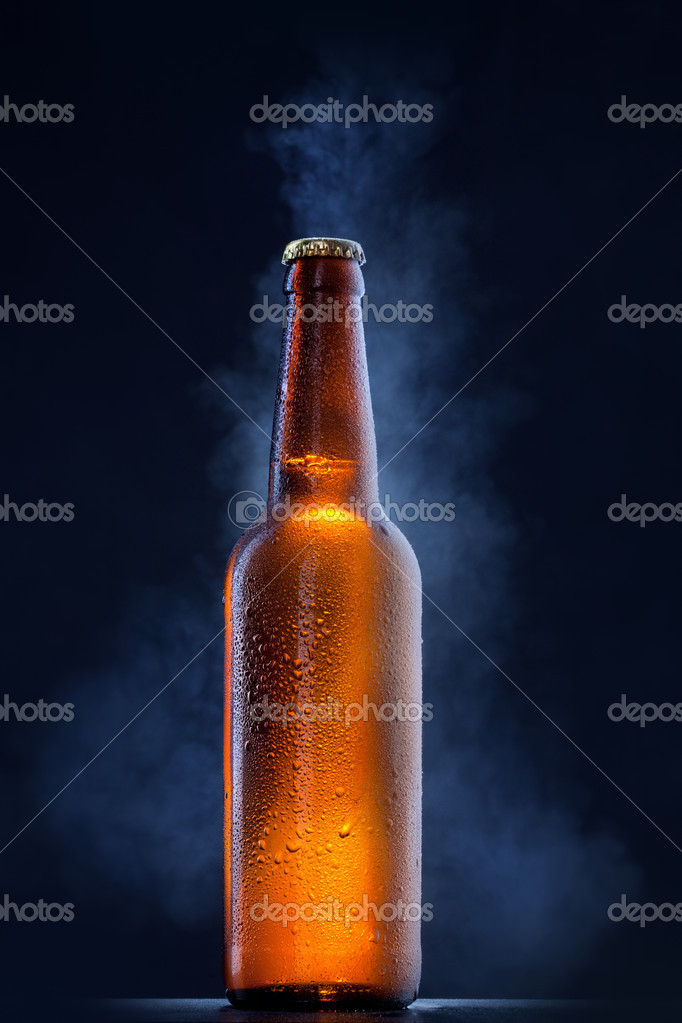 Cold beer bottle with drops, frost and vapour on black — Stock Photo #8910877