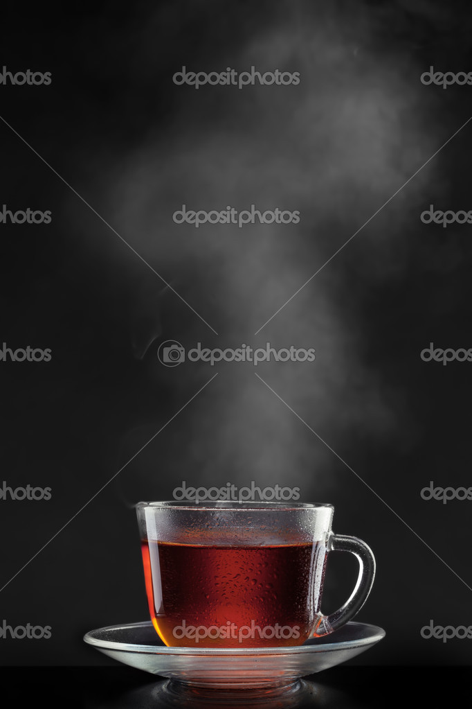 Cup with hot tea and steam on black — Stock Photo #9029106
