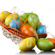 Color easter eggs in basket isolated on white. top view - Stok fotoğraf