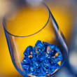 Ice in wineglass on color background - Stok fotoğraf