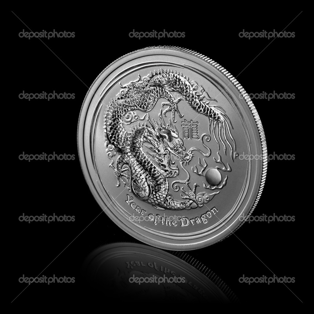 Year of dragon. silver coin isolated on black — Stock Photo #9382776