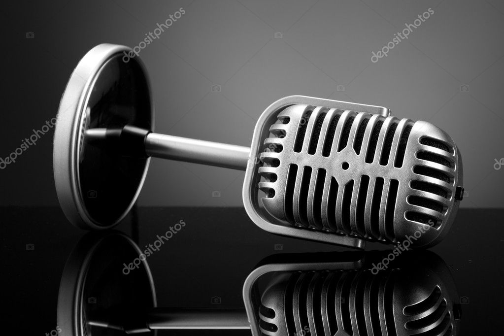 Retro microphone on grey — Stock Photo #9539596