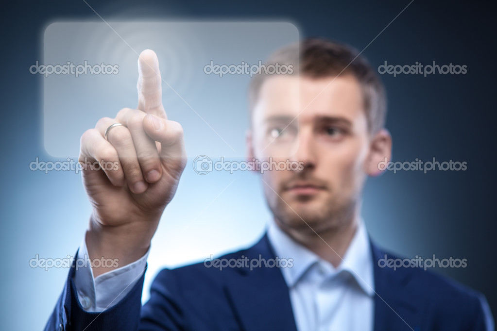 Business man pressing touchscreen button — Foto de Stock   #9697581