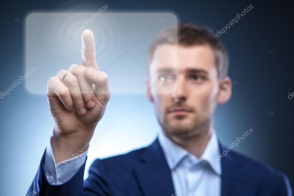 Business man pressing touchscreen button — Stockfoto #9697581