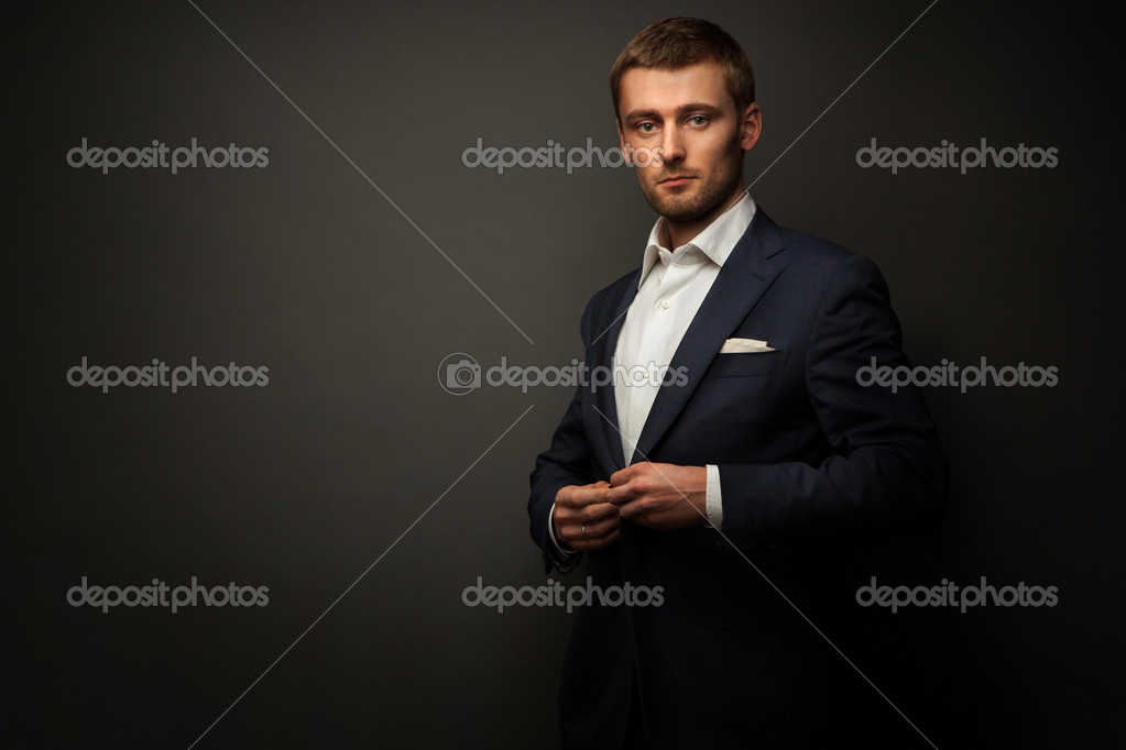 Handsome businessman on black — Stock Photo #9823993