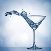 Martini splash in glass — Stock Photo