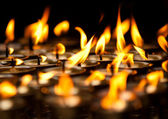 Close up of Candles at Buddhist temple — Stock Photo