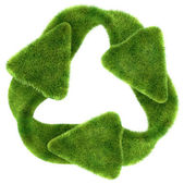 Ecological sustainability: green grass recycling symbol — Stock Photo