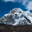 Stock Photo: Snowed up mountain peaks and clouds in Himalayas