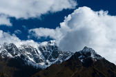 Snowed up mountain range and clouds in Himalayas — Stock Photo
