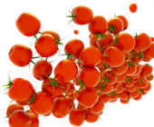 Tasty red tomatoes flow over white — Stock Photo
