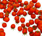 Tasty red cherry tomatoes flow over white — Stock Photo