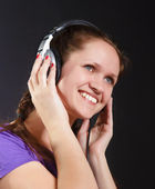 Smiling girl in the headphones — Stock Photo