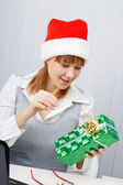 Girl in the office with a New Year gift — Stock Photo