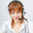 Girl in headphones with a microphone — Stock Photo #8410206