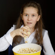 Royalty-Free Stock Photo: Girl with popcorn