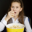 Girl in a movie theater — Stock Photo