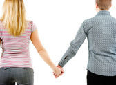 A young couple holding each other's hands — Stock Photo