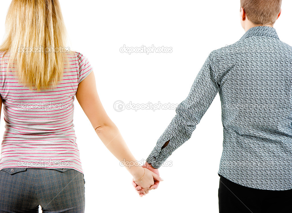 A young couple holding each other's hands. View from the back — Stock Photo #9963691