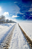Snowy winter road — Stock Photo
