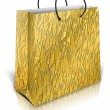 Gold gift bag - Stock Photo