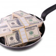 Dollars in frying pan — Stock Photo